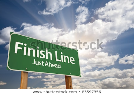 Finish Line on Green Direction Sign. Stock photo © tashatuvango