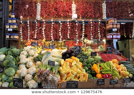 onions and tomatoes for sale at a market stall stock photo © bmonteny