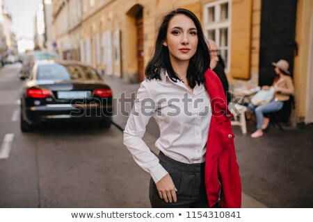Stylish young business woman wearing dark suit confident and relaxed stock photo © darrinhenry
