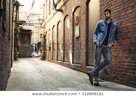 fashion man leaning on a brick wall Stock photo © feedough
