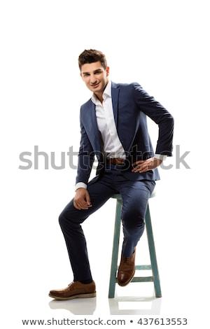 Fiatal divat férfi ül zsámoly mosolyog Stock fotó © feedough