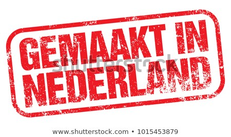 made in netherlands   red rubber stamp stock photo © tashatuvango