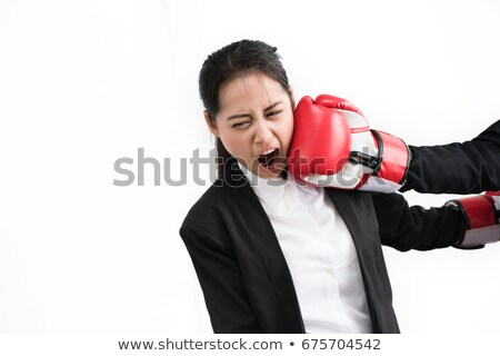 Stock photo: portrait of a young caucasian businesswoman tired with boxing gloves