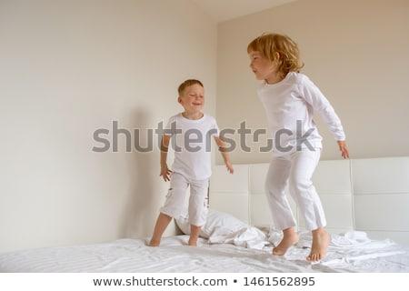 Little girl in nightwear on white Stock photo © velkol
