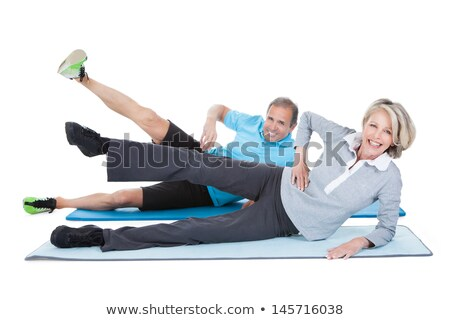 Sports man stretching on the mat over white background Stock photo © deandrobot