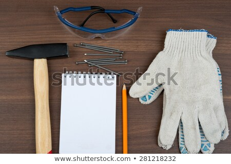 Welding goggles with note pad and nails on table Stock photo © cherezoff
