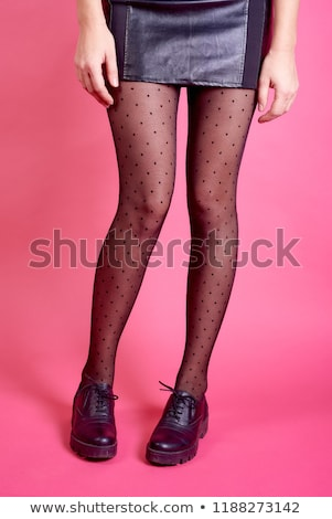 Studio photo of the female legs in colorful tights stock photo © filipw