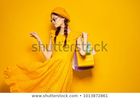 Stock fotó: Pretty Young Woman In Summer Yellow Clothing Isolated On White