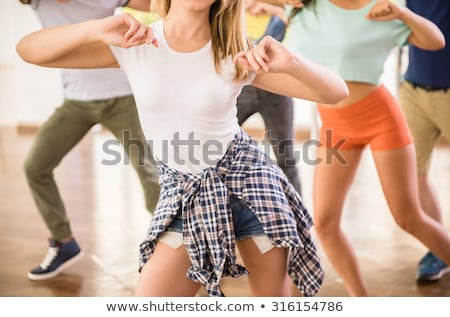 young man dancing ballet at gym stock photo © deandrobot