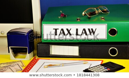 Office folder with inscription Taxes. Stock photo © tashatuvango