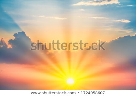 Clouds and sunrays at sunrise Stock photo © Juhku