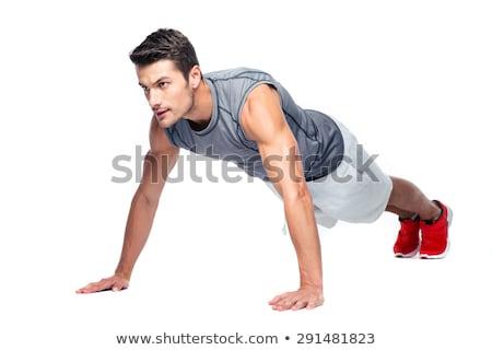 man doing exercises isolated on white stock photo © elnur