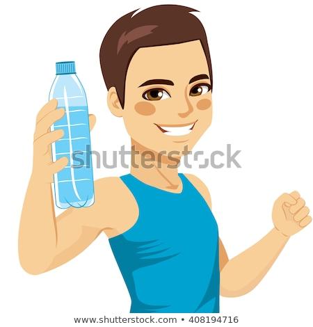 Bodybuilder une bouteille d'eau eau sport hommes Photo stock © Jasminko