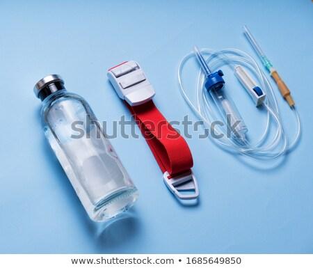 seringa · cair · agulha · azul · água · médico - foto stock © arsgera
