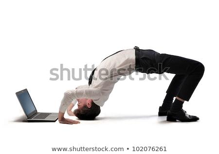 Stockfoto: Acrobatisch · zakenman · zakenman · laptop · computer · man