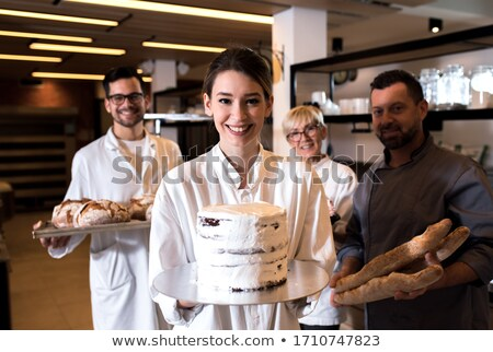 Female hands working on unfinished dough Stock photo © deandrobot