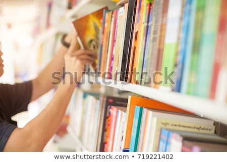 man searching book in library stock photo © deandrobot