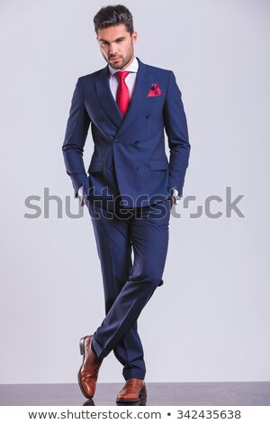 man in suit posing legs crossed while having hands in pockets Stock photo © feedough