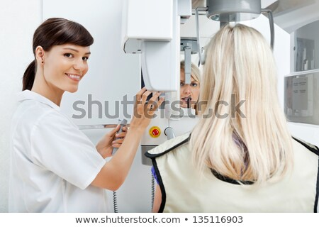 Patient Getting Dental Checkup At Clinic Stock photo © AndreyPopov