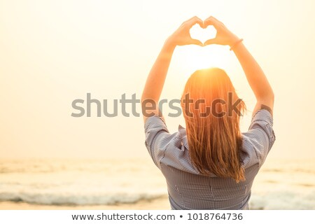 woman depicts the heart as hands stock photo © paha_l
