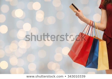close up of woman with shopping bags and bank card stock photo © dolgachov