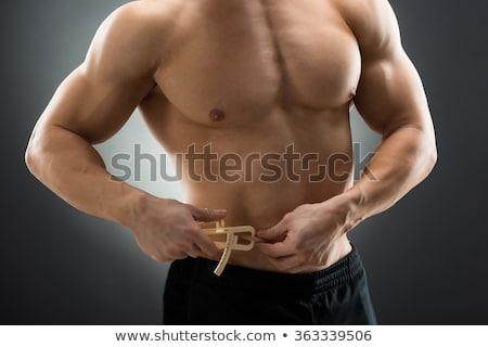Muscular hombre grasa vientre negro Foto stock © AndreyPopov