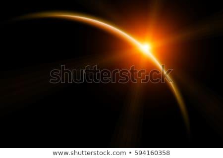 Sun rising behind fictional planet Stock photo © kjpargeter