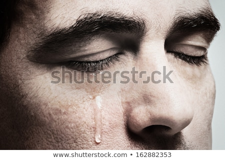 Grieving man with eyes closed. stock photo © RAStudio