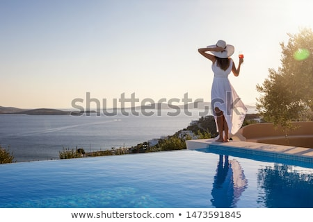 Belo mulher jovem em pé piscina preto biquíni Foto stock © artfotodima