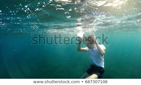 Boy drowning under the water Stock photo © bluering
