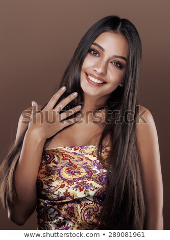 cute happy young indian woman in studio close up smiling fashion mulatto stock photo © iordani