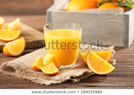 Portakal suyu cam taze meyve yaprakları ahşap Stok fotoğraf © yelenayemchuk