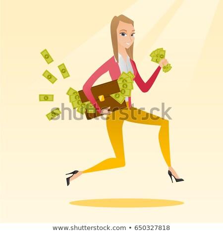 Femme d'affaires serviette plein argent courir Photo stock © RAStudio