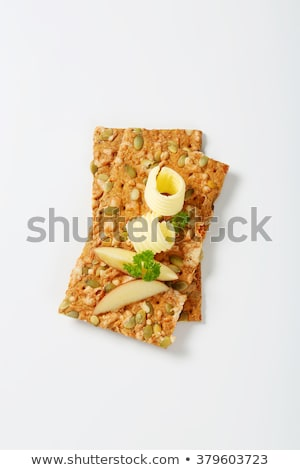pumpkin seed crackers with butter and apple stock photo © digifoodstock