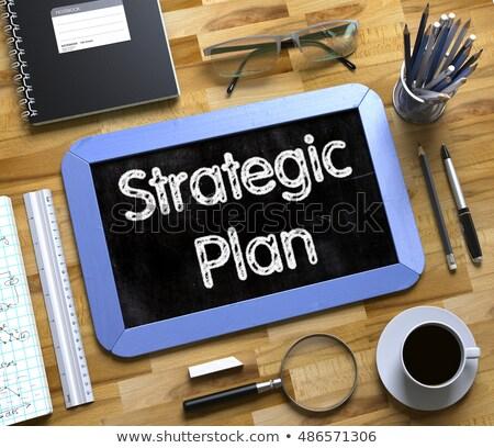 strategic plan handwritten on small chalkboard 3d stock photo © tashatuvango