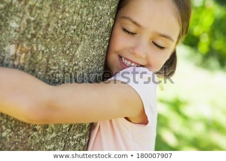 Young girl hugging tree eyes closed Stock photo © IS2