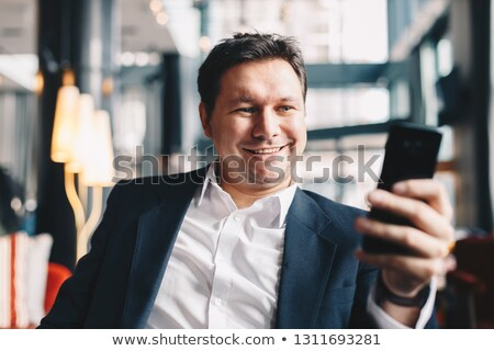 Businessman at bar looking at his mobile Stock photo © IS2