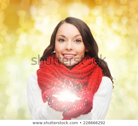woman holding snowflake stock photo © lightfieldstudios
