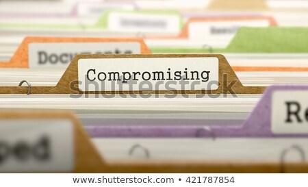 file folder labeled as compromising stock photo © tashatuvango