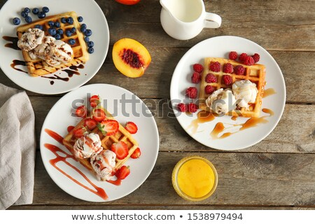 Assortment of Belgium waffles with cream and toppings. Stock photo © kasto