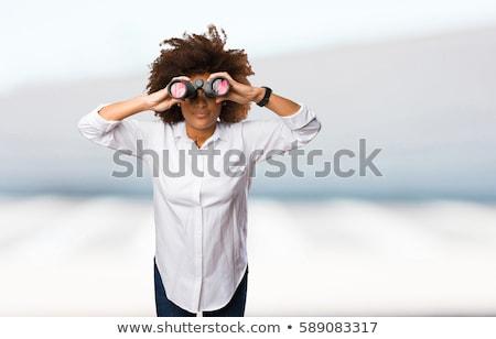Mulher jovem olhando binóculo branco feminino sorridente Foto stock © wavebreak_media