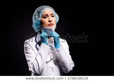 Feminino cirurgião máscara cirúrgica cirurgia operação Foto stock © stevanovicigor