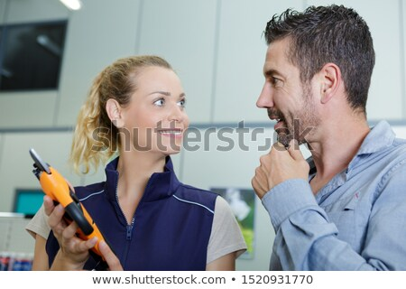 home improver couple buying paint and painter tools in hardware store stock photo © kzenon