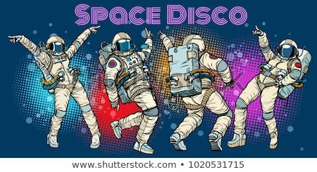 Disco. Woman astronaut dancing Stock photo © studiostoks