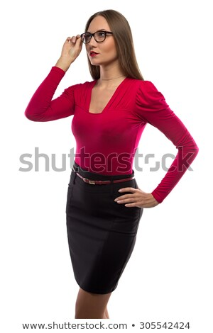 Photo of serious woman in white shirt and black skirt looking up Stock photo © deandrobot