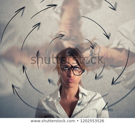 Confused businesswoman has dizziness. Concept of stress and overwork Stock photo © alphaspirit
