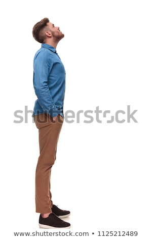 relaxed casual man waiting in line looks up at something Stock photo © feedough