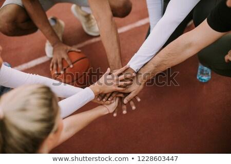 Haut vue basket équipe mains tenant tribunal Photo stock © boggy