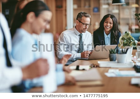 Two businesspeople in boardroom with laptop Stock photo © monkey_business