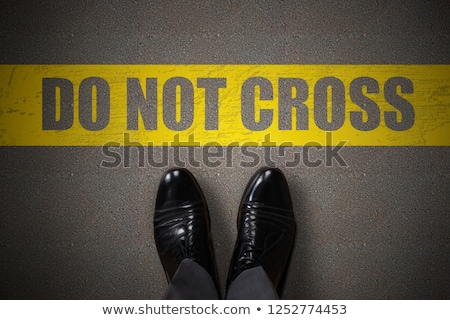 Person Standing Near Do Not Cross Text Stock photo © AndreyPopov